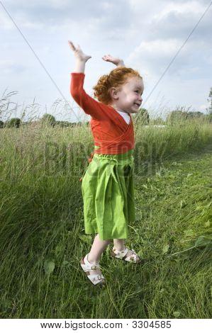 Little Gilr In Grass Field