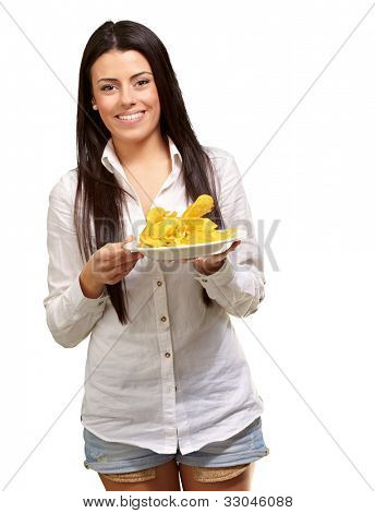 portrait of a young woman holding a potato chips plate over a white background