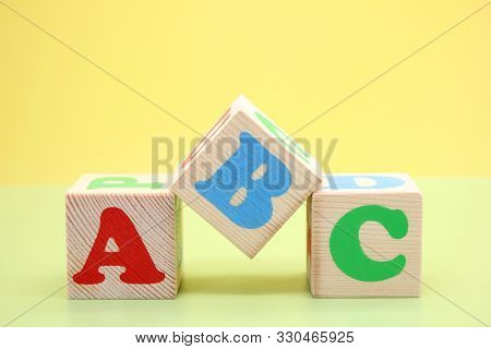 Abc -the First Letters Of The English Alphabet On Wooden Toy Cubes. Learn Foreign Languages. English