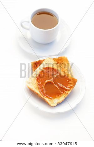 Tea And Toast With Caramel Isolated On White