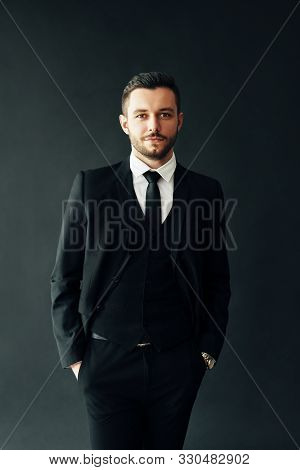 Portrait Of Elegant Young Man In Suit On Black Background. Handsome Male Concept