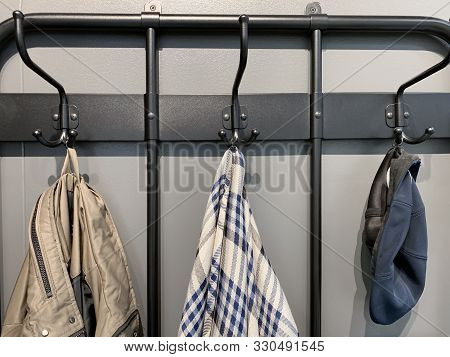 Outerwear, Coat Hanging On A Hook Of A Coat Rack In Hallway, Anteroom At Home.