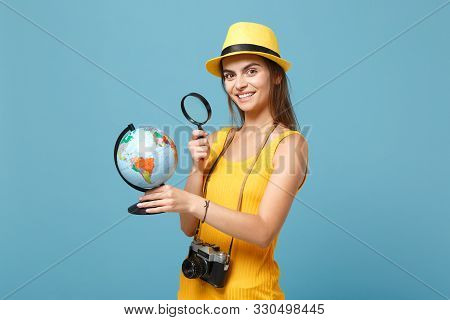 Traveler Tourist Woman In Yellow Summer Casual Clothes, Hat With Globe, Camera Isolated On Blue Back