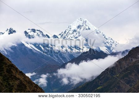 Mount Salkantay In The Middle Of Clouds, View From Choquequirao Trekking Trail, Cuzco Area, Machu Pi