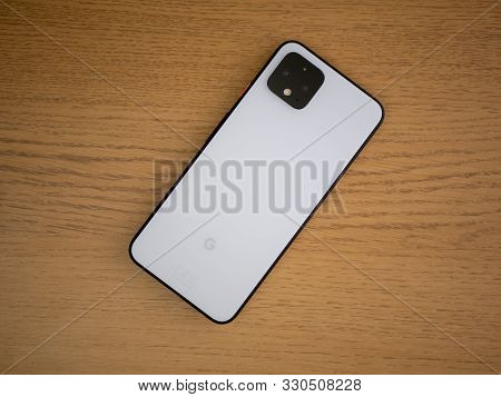 Uk, October 2019: Pixel 4 Smart Phone On Coffee Table Face Down With Camera Up