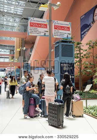 Osaka, Japan, 24 June 2019 People Standing Next To Airport Waiting For G20 Announcement In Airport (