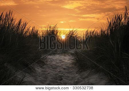 Sand Pathway Through High Grass At Sunset, On Sylt Island. Golden Hour Over Northern German Beach. S