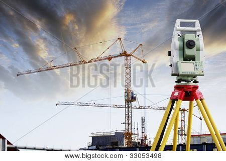 total-station, geodesy technology and construction industry in background