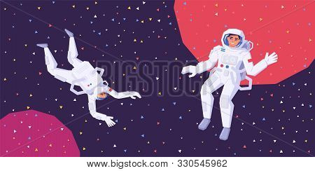 Astronauts Man And Woman Fly In Zero Gravity In Outer Space. The Research Of The Galaxy, Space And U