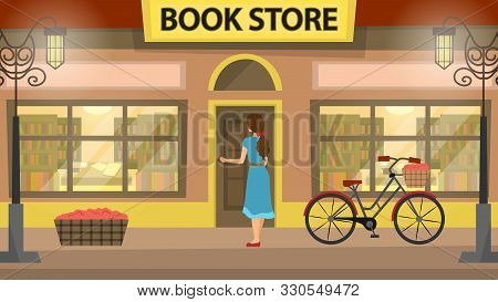 Bookshop, Bookstore Building Facade With Girl. A Lot Of Books On The Shelves. Beautiful Bicycle Near
