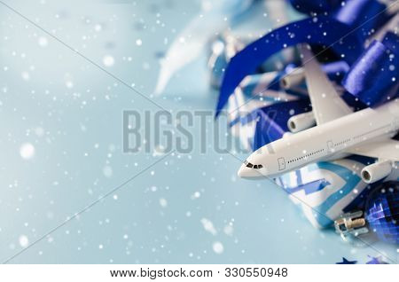 Christmas Travel Planning. Traveling As Gift. White Blank Model Of Passenger Plane, Passports And Gi