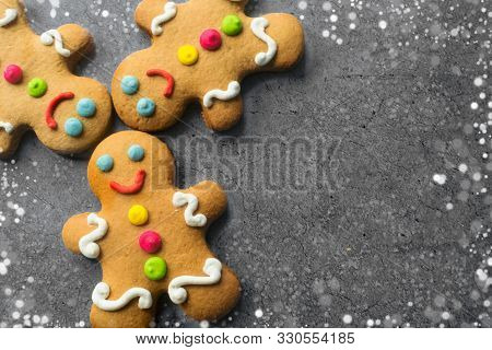 Delicious Christmas Gingerbread Men.christmas Baking Ingredients And Supplies On Dark Background.pos