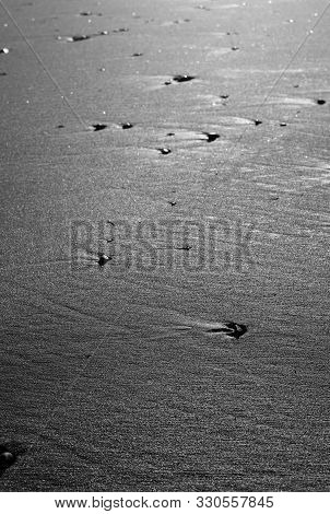 Black Volcanic Sand Ackground Texture Abstract B With Copyspace. Black Beaches Of Iceland.