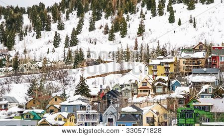 Panorama Houses And Cabins On A Mountain Blanketed With Snow In Park City Utah In Winter