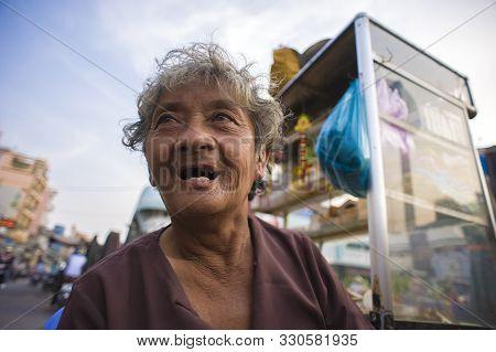 Ho Chi Minh City (saigon), Vietnam - February 17, 2011: Homeless Vietnamese Woman Wandering Around T