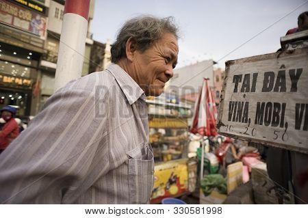 Ho Chi Minh City (saigon), Vietnam - February 17, 2011: Senior Vietnamese Man Shopping In A Food Mar