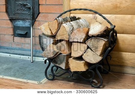 A Bucket With A Birch Broom, A Wood Stove And Other Accessories For The Sauna Are In The Steam Room