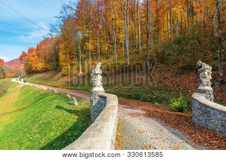 Beautiful Fall Scenery In The Park. Walkway Along The Grassy Meadow On The Slope And Forest In Color