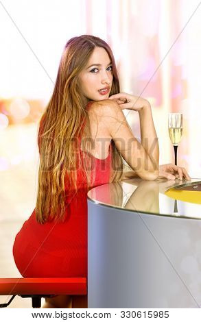 beautiful single woman in red dress with glass of champagne on party