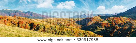 Mountain Countryside On A Sunny Autumn Evening. Gorgeous Afternoon Weather With Fluffy Clouds On The