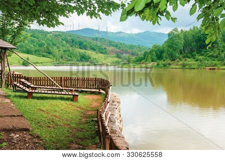 Place For Rest On The Shore Of Mountain Lake. Beautiful Nature Scenery In Spring Time.place For Rest