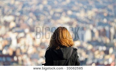 Girl Observing A City