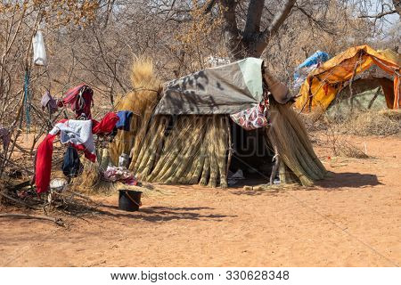 Group of shacks in a refugee camp in Africa made from thatching grass