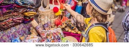 Banner, Long Format Boy At A Market In Ubud, Bali. Typical Souvenir Shop Selling Souvenirs And Handi
