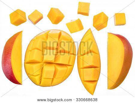 Set of mango cubes and mango slices isolated on a white background.