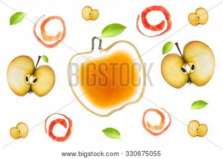 A Small Bowl With Applesauce, Apple Slices, Apple Peels And Leaves Isolated Backlit On A Light Table