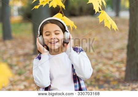Best Song About Fall. Cute Small Child Enjoy Song Playing In Headphones. Adorable Little Girl Sing A