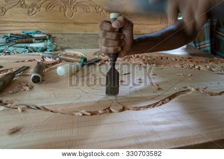 Hands Of Craftsman Carve With A Carve Tools In The Hands.traditional Craftsman Carving Wood.