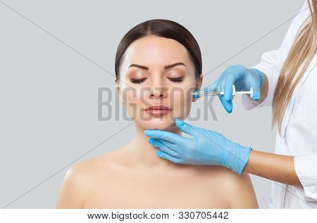 The Doctor Cosmetologist Makes The Rejuvenating Injections Procedure For Tightening And Smoothing Wr