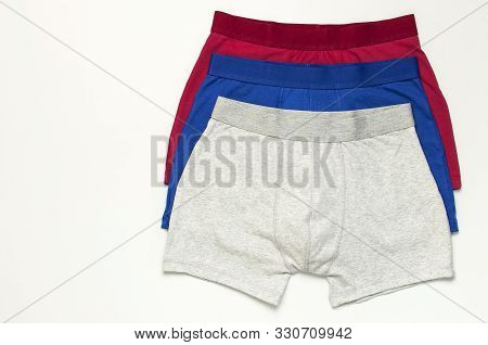 Men's Underwear, Set Of Multi-colored Underpants On White Background Flat Lay Top View Copy Space. F