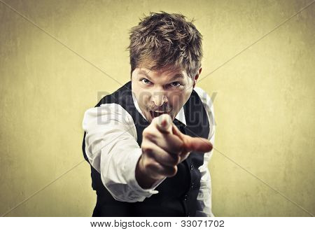 Angry man pointing his finger against somebody
