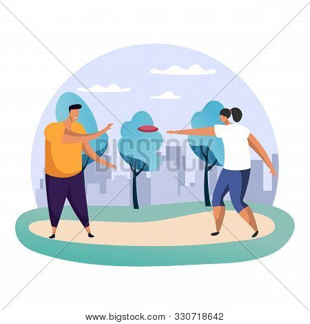Boy And Girl, Man And Woman Playing Frisbee At Park. Male And Female At Flying Disc Game In Front Of