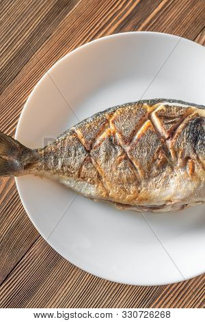Fried Sea Bream On The Plate: Top View