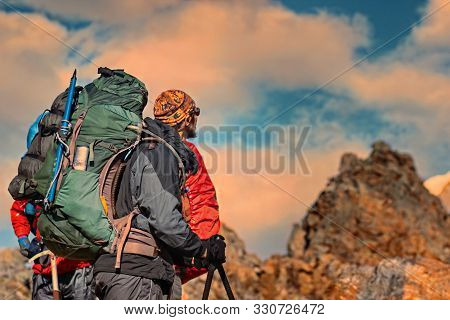 Man Traveler With Big Backpack Mountaineering Travel Lifestyle Concept Lake And Mountains On Backgro