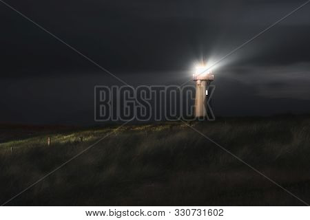 Night Landscape With A Lighthouse On Dunes With High Grass, On Sylt Island, On North Sea Coastline G