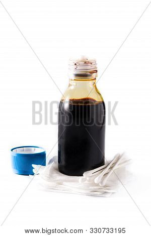 Medical iodine in a bottle and gauzes isolated on white background. poster