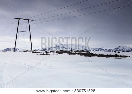 The Large Power Lines Stretch Across The Icelandic Highlands