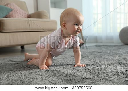 Cute Little Baby Crawling On Soft Carpet Indoors