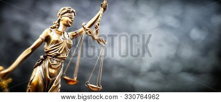Legal law concept statue of Lady Justice with scales of justice