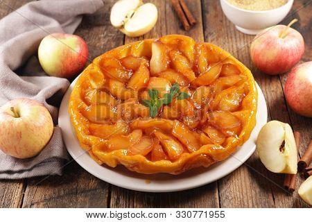 tarte tatin, french apple pie on wood background