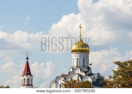 Gilded Dome Of Christian Church And Top Of Belltower Against Sky
