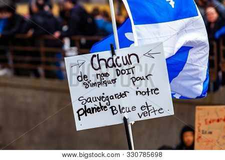 A French Placard Reads Each Of Us Must Get Involved To Safeguard Our Blue And Green Planet, Seen Clo