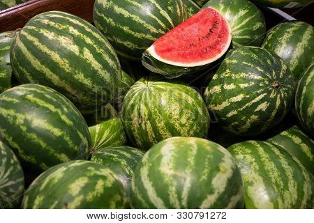 Close-up Of Mellow Water-melons In Box In Grocery Store. Photo With Depth Of Field