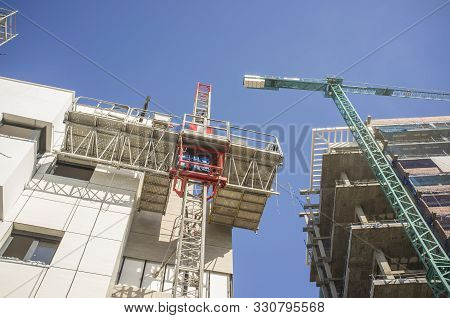 Transport Platforms Of Scaffold Elevator At Construction Site. Low Angle View