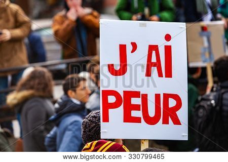 A Close-up View Of A French Placard, Saying Im Afraid, Held By A Protestor As Ecological Activists M