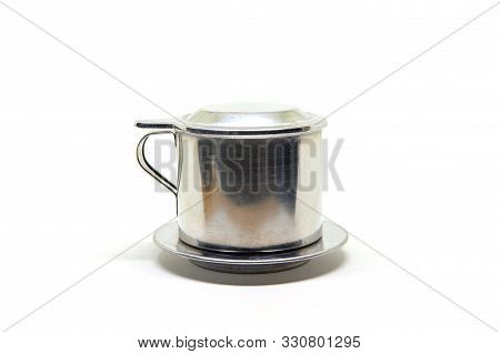 Vietnamese Coffee Press On White Background. Metallic Coffee Filter Cup. Brewing Coffee In Vietnam.